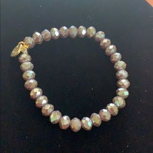 Irridescent beaded bracelet with gold accent